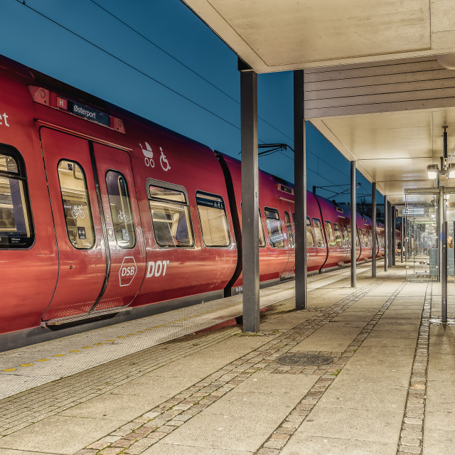 """""""Emty railroad station at night with a red train"""" stock image"""