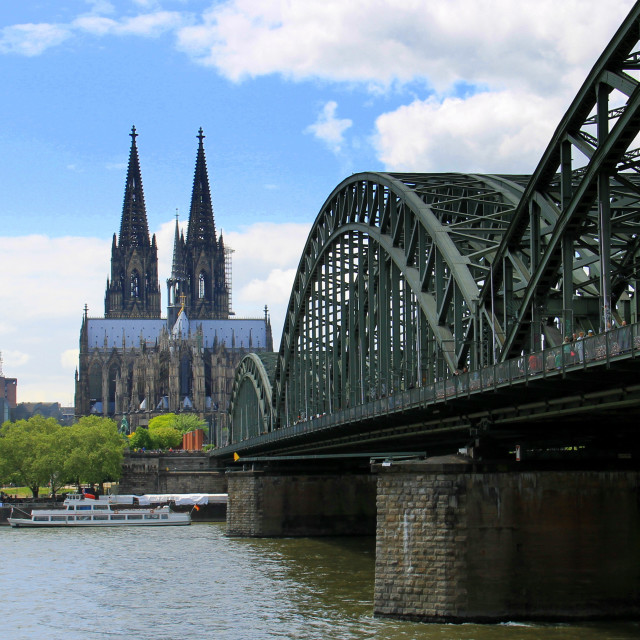 """""""The Hohenzollern Bridge over the Rhine, leading to Cologne Cathedral."""" stock image"""