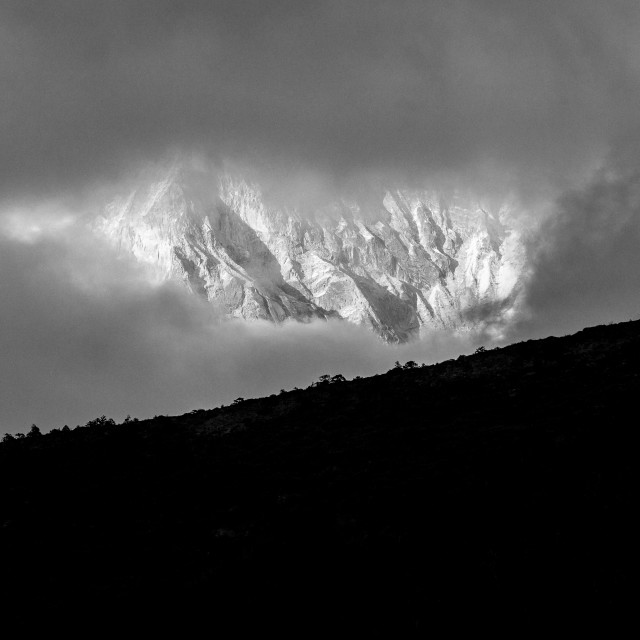 """""""A window in the evening cloud showing the west face of Ama Dablam"""" stock image"""