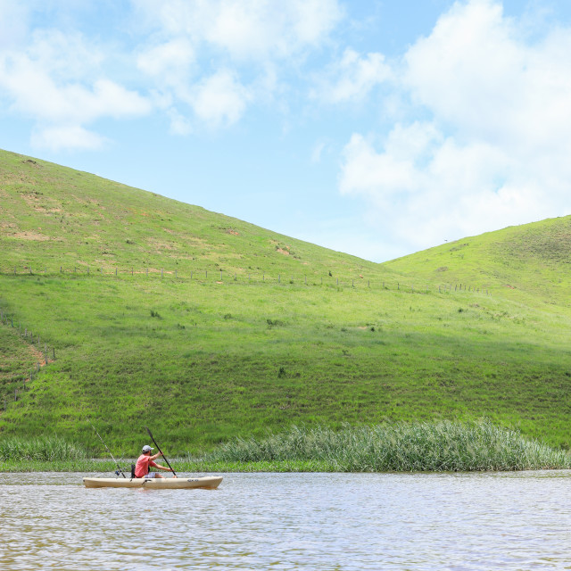 """Kayaking fishing in the waters of the Gloria River, Brazil"" stock image"