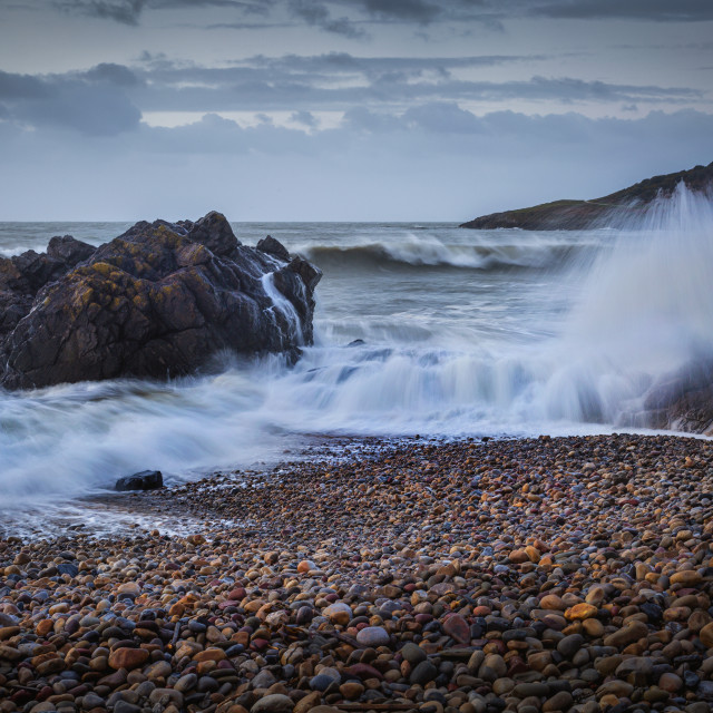 """Crashing waves on Rotherslade Bay"" stock image"