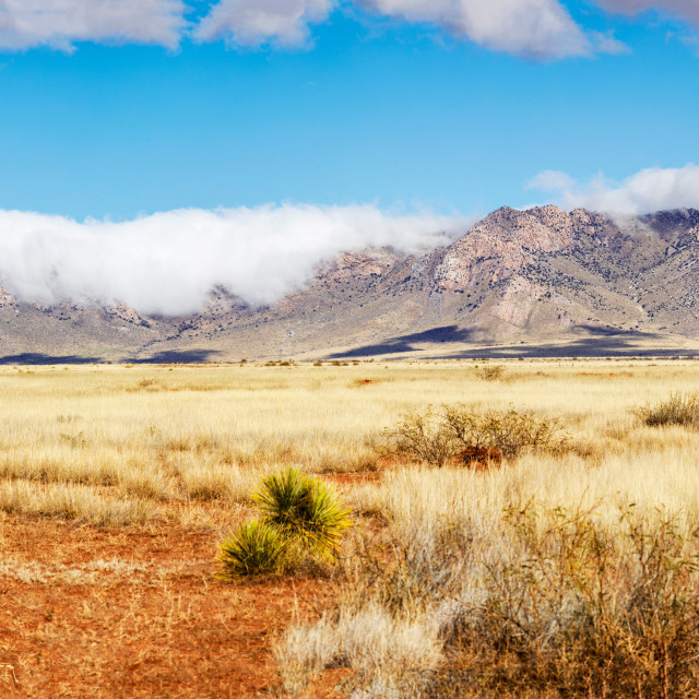 """""""Low Hanging Clouds Over Southern Arizona Mountains"""" stock image"""