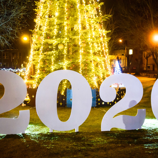 """""""Year 2020 sign in front of Christmas tree. Gulbene, Latvia."""" stock image"""