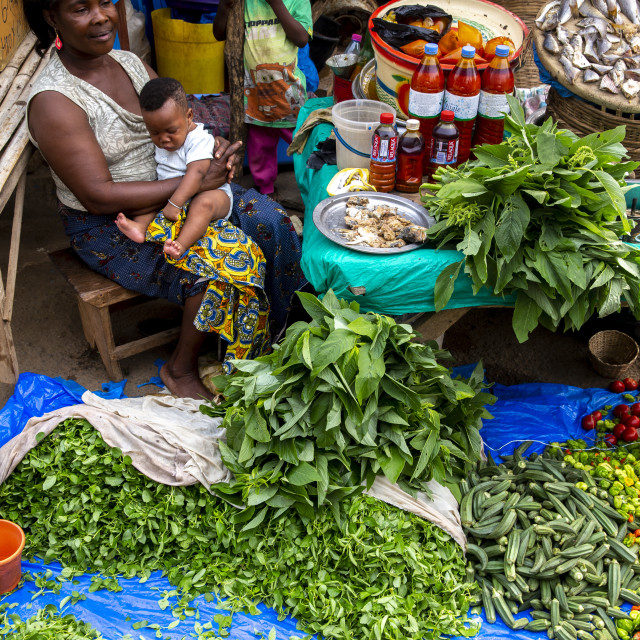 """""""Woman selling vegetables at Kpalime market, togo."""" stock image"""