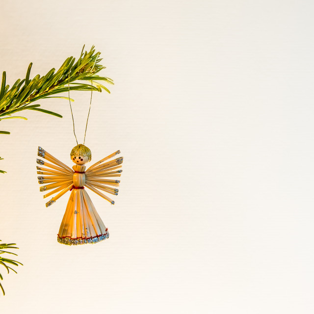 """""""Angel made of straw, hanging in a green branch of a christmas tr"""" stock image"""