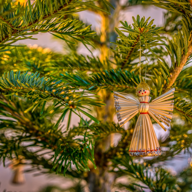 """""""Angel made of straw, hanging in a christmas tree"""" stock image"""