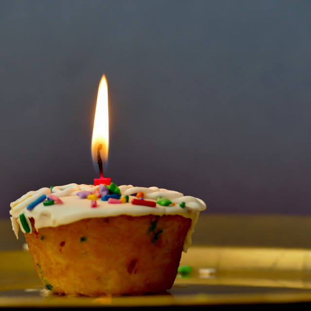"""""""Cupcake with a candle on dark background"""" stock image"""