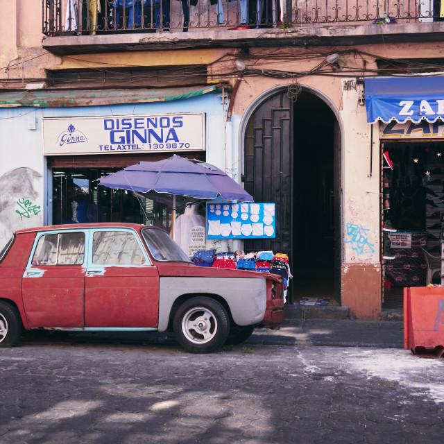 """""""Old red car in Mexican road in centre of Puebla city, Puebla de Zaragoza, Mexico, in January 20, 2019"""" stock image"""