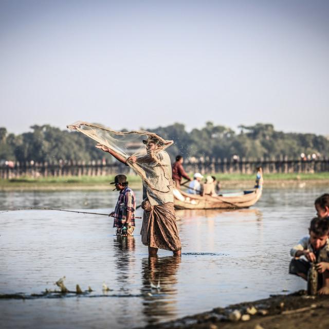 """""""Man fishing at lake near ubien bridge"""" stock image"""