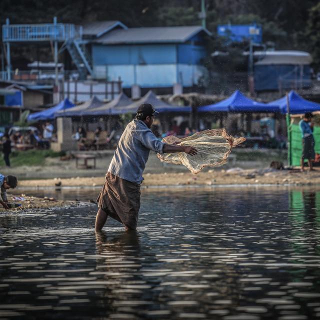 """""""man fishing at ubien bridge"""" stock image"""