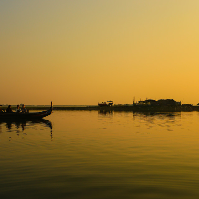 """""""silhouette of boat on lake at sunset"""" stock image"""