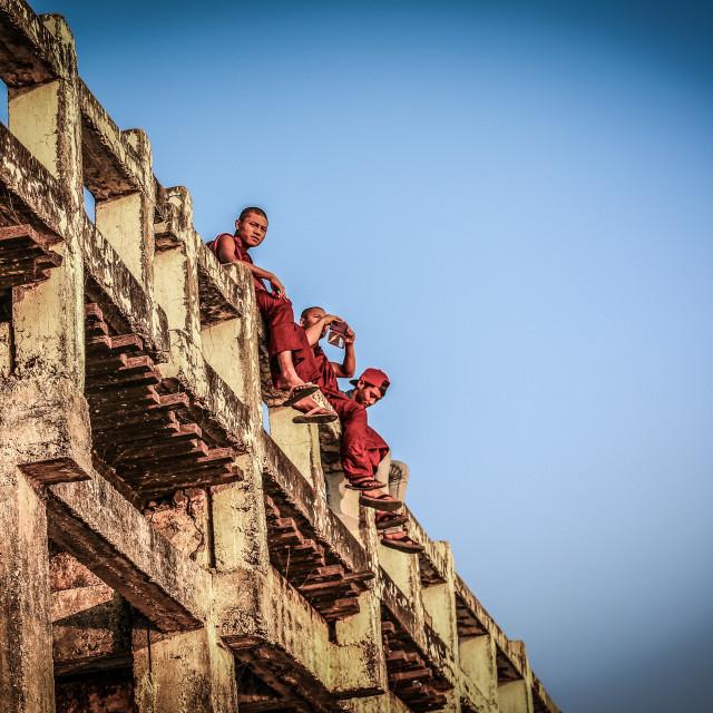 """monks sitting on ubien bridge"" stock image"
