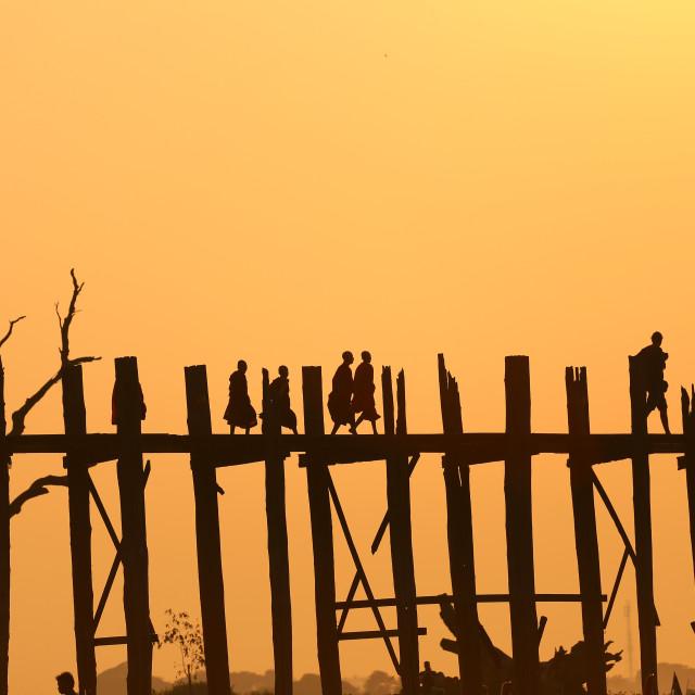 """""""silhouette of people walking on ubien bridge"""" stock image"""