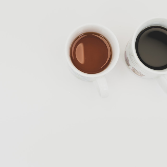 """coffee and tea cups on a white surface"" stock image"