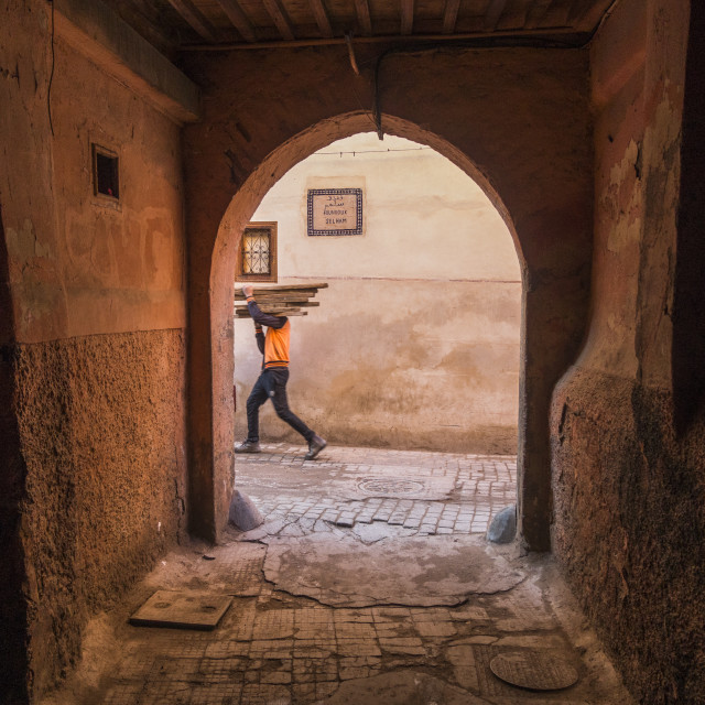 """Narrow passage in medina of Marrakech with boy passing by, Morocco."" stock image"