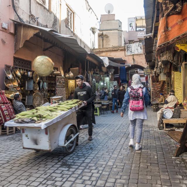 """Souk Marrakesh, the the Souk, Medina, Marrakech, young man carrying food, Morocco."" stock image"