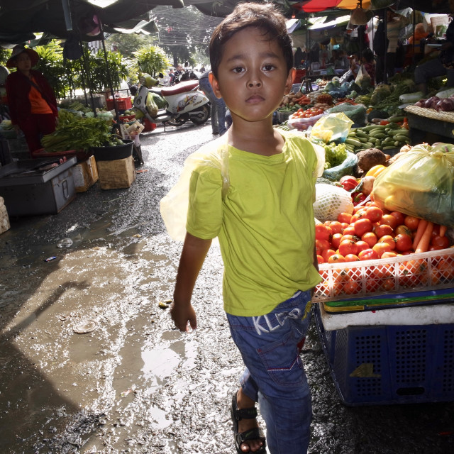 """Young boy in market"" stock image"
