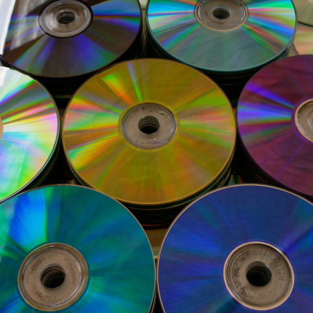 """""""Multiple stacks of DVDs of different colours"""" stock image"""