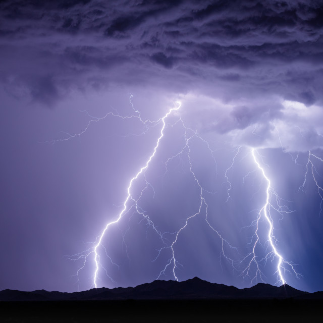 """""""Lightning strikes from a dramatic monsoon thunderstorm"""" stock image"""