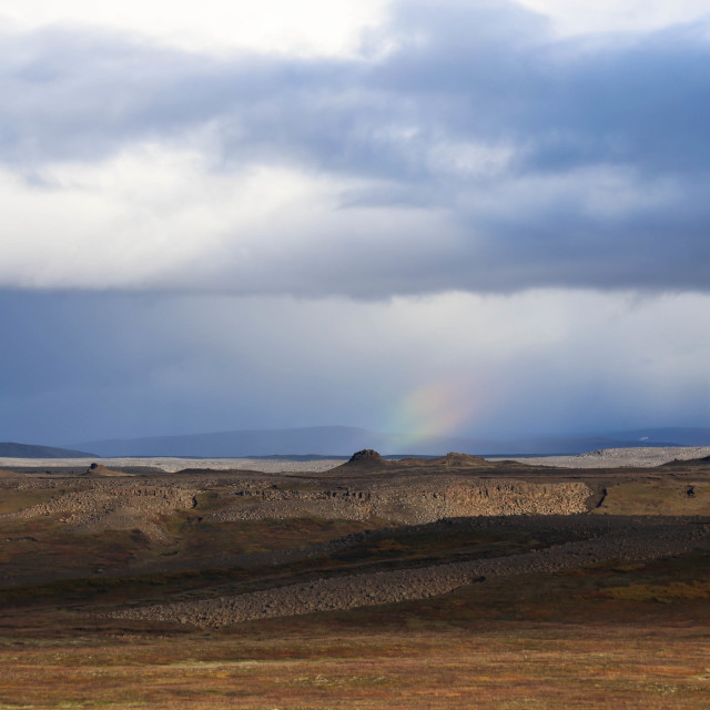 """Rainbow among Rain Clouds over Iceland"" stock image"