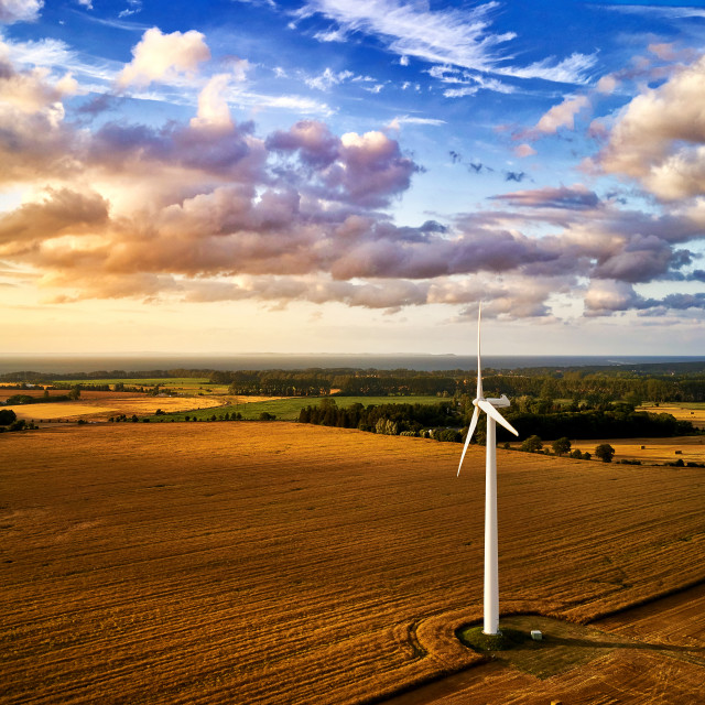 """wind turbine power generator on a field in harmonic mood atmosp"" stock image"