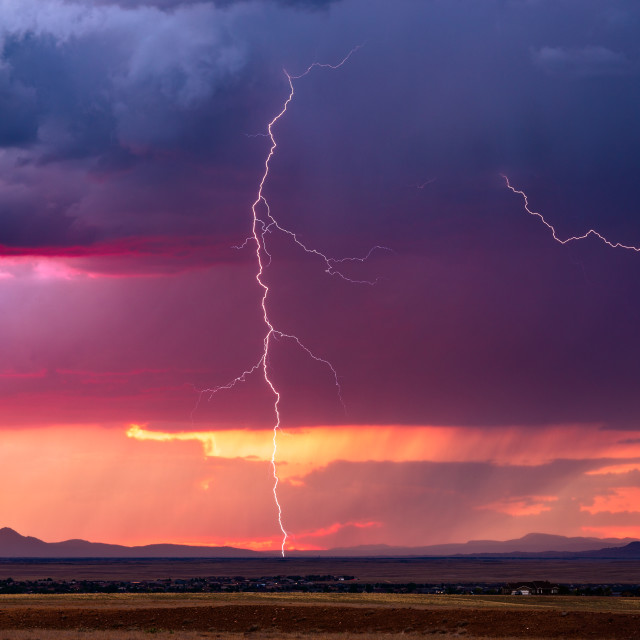 """Lightning storm at sunset"" stock image"