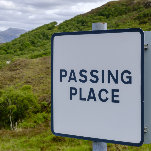 """""""Passing place sign to allow overtaking on a narrow road, in Scotland"""" stock image"""