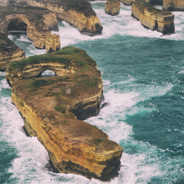 """Loch Ard Gorge and Arch Island from helicopter during a storm - Great Ocean..."" stock image"