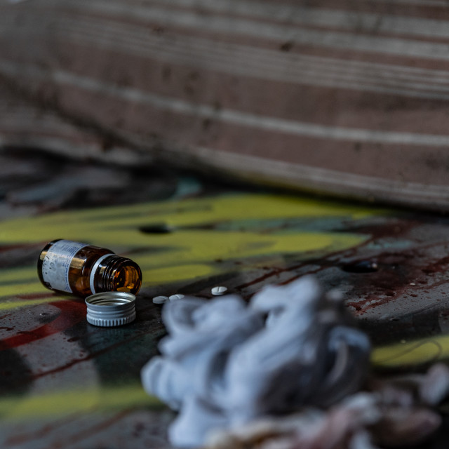 """""""medicines scattered on an old bed of an abandoned madhouse"""" stock image"""