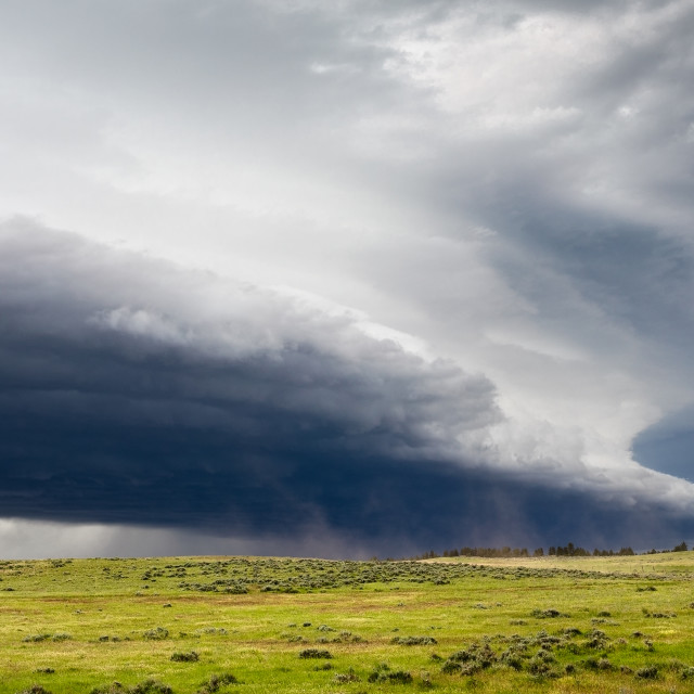"""""""Dramatic storm clouds gather ahead of a supercell thunderstorm"""" stock image"""