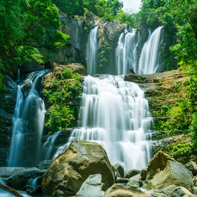"""The tapering Nauyaca Waterfalls in Costa rica, a majestic cascading fall in..."" stock image"