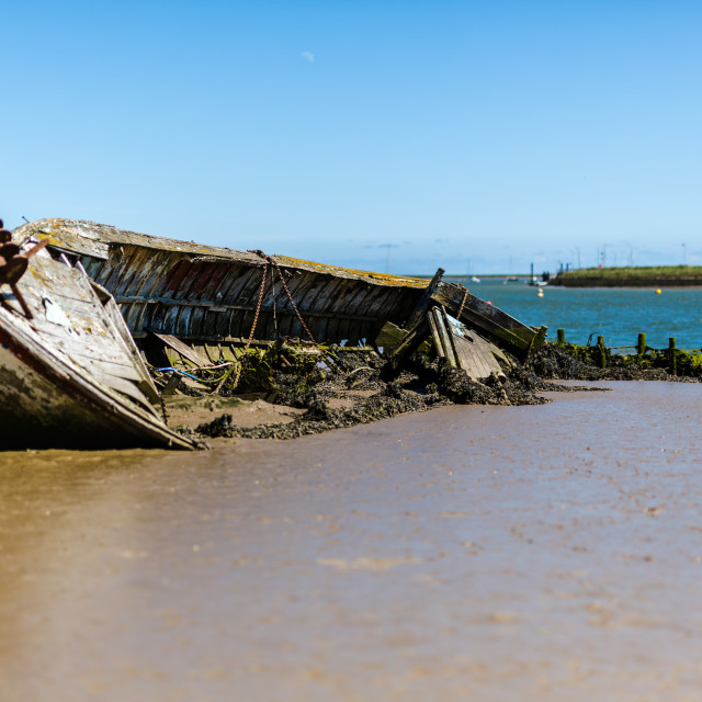 """An abandoned ship wreak that is beached up on Orford beach in Suffolk"" stock image"