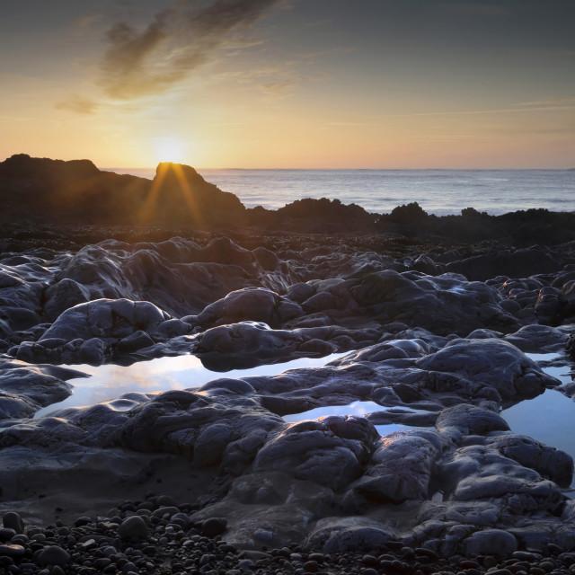 """""""Sunrise at Bracelet Bay"""" stock image"""