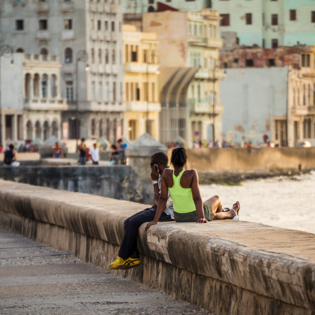 """""""Locals line up on the Malecon"""" stock image"""
