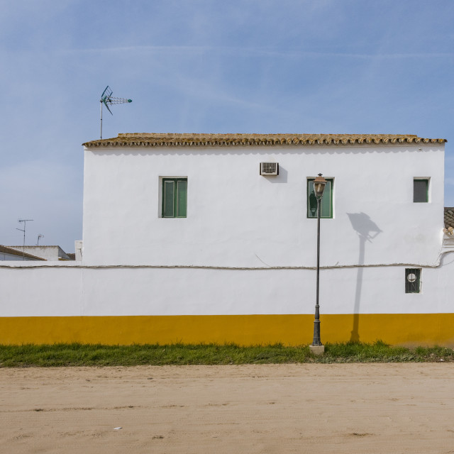 """""""Andalusian building and sandy streets of El Rocio, Andalucia, Spain"""" stock image"""
