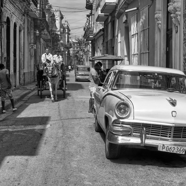 """People and a classic car in Havana Cuba"" stock image"