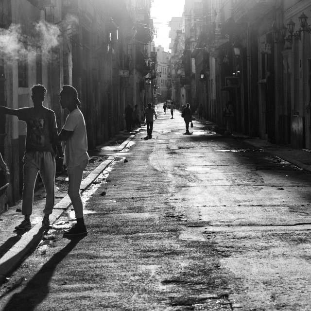 """Young Cubans back lit in the early morning sunshine"" stock image"