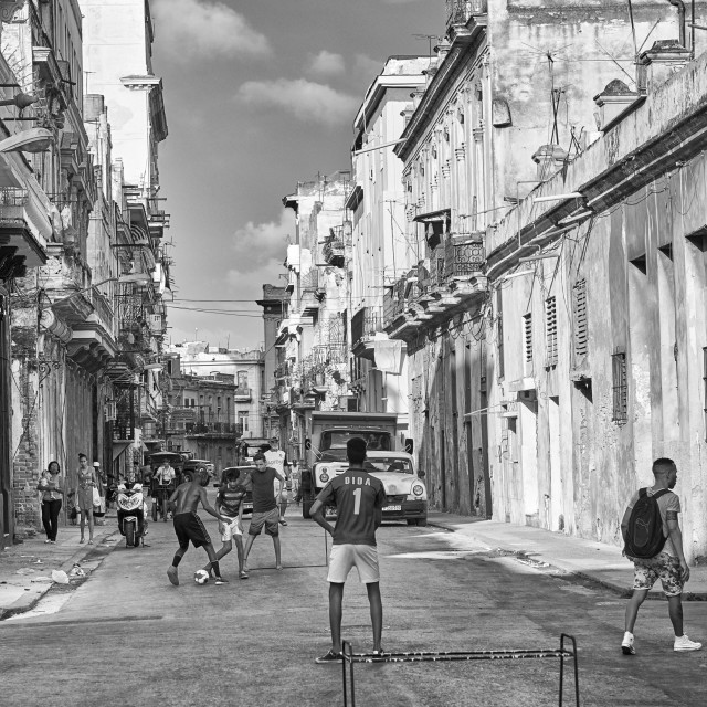 """Children play football (soccer) on the streets of Havana, Cuba"" stock image"