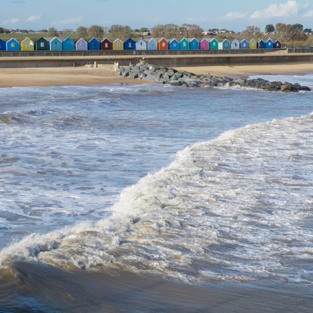 """Rolling waves and Beach Huts Southwold"" stock image"