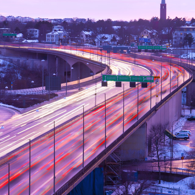 """Sweden, Stockholm - Traffic on Essinge Highway at Dusk"" stock image"