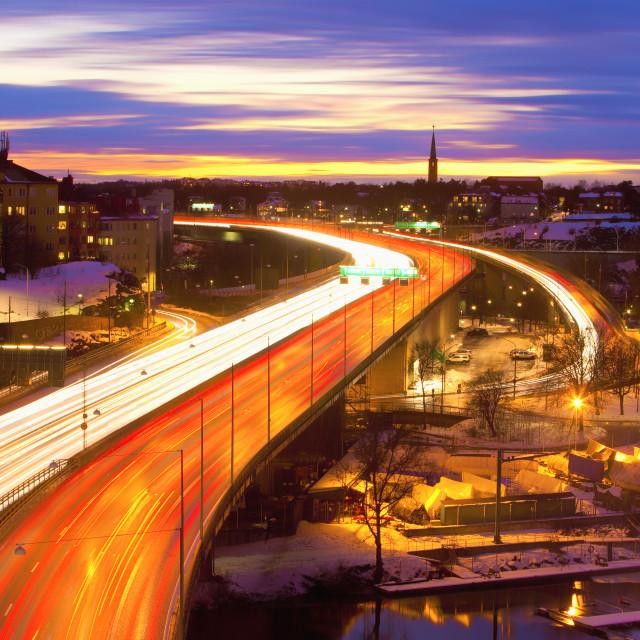 """""""Sweden, Stockholm - Traffic on Essinge Highway at Dusk"""" stock image"""