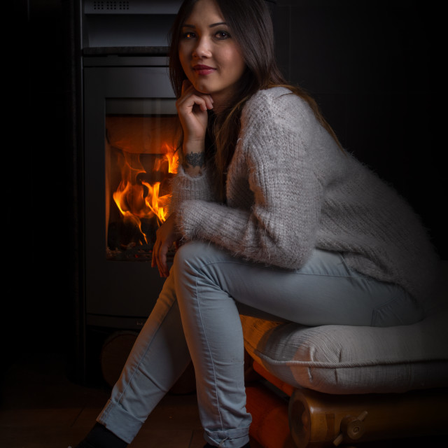"""""""at the fireplace"""" stock image"""