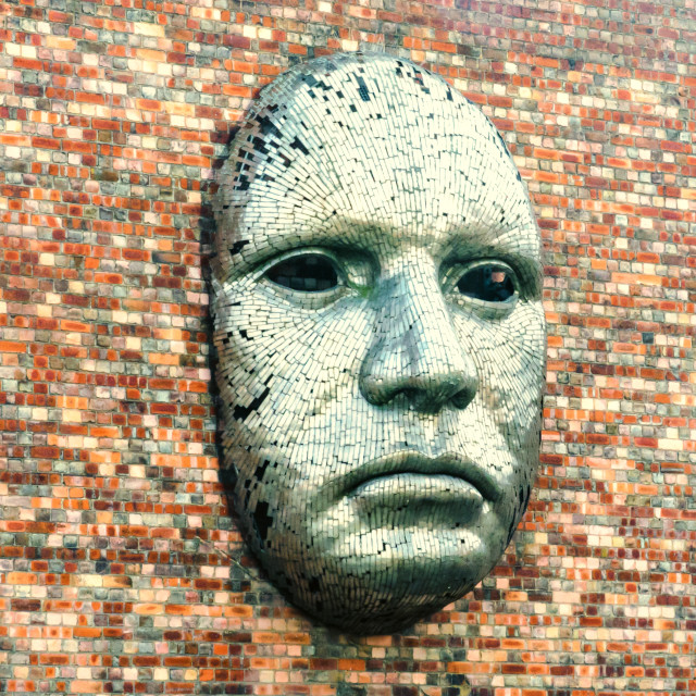 """""""Metal face sculpture on the outside wall of Drill Hall"""" stock image"""
