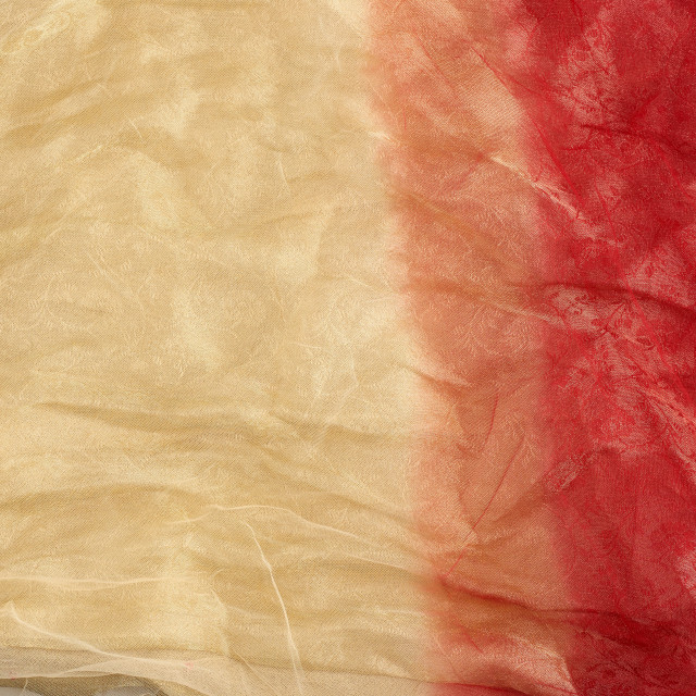 """""""crumpled yellow-red tulle, fabric for sewing clothes, full frame"""" stock image"""