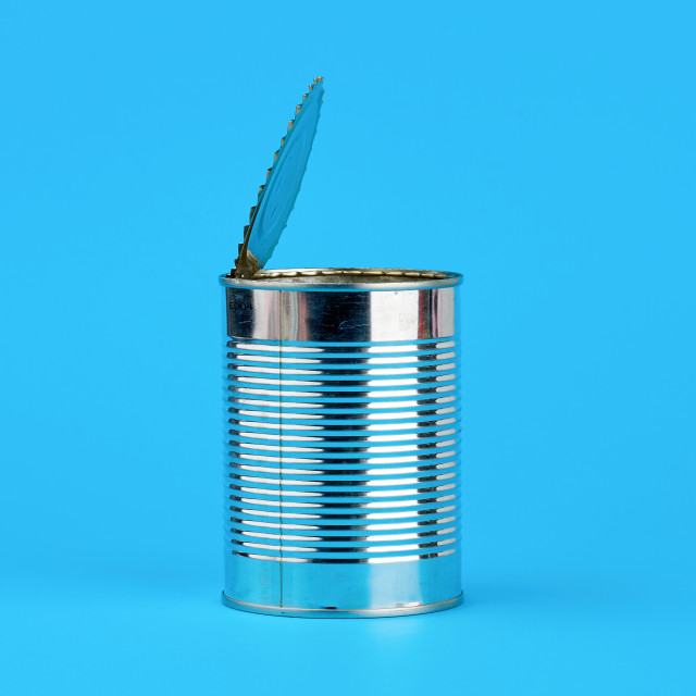"""""""open hard iron can for food preservation on a blue background"""" stock image"""