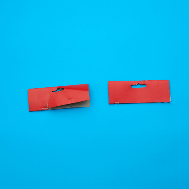 """""""two red cardboard pieces of paper on a blue background"""" stock image"""