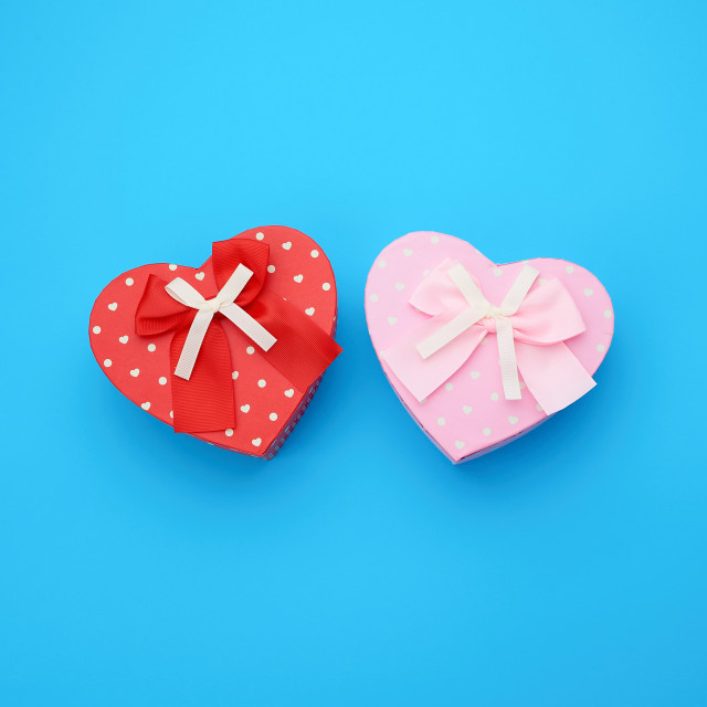 """""""red and pink gift box in the form of a heart with a bow on a blu"""" stock image"""