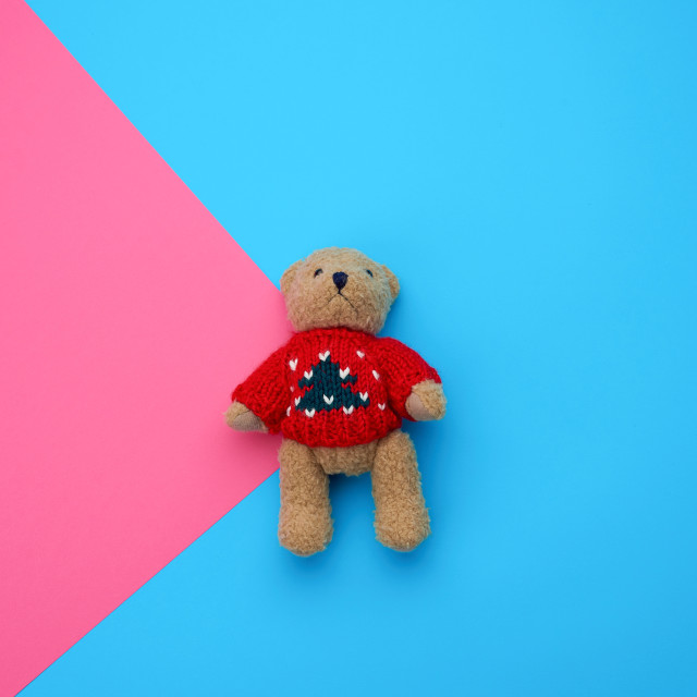 """""""little cute brown teddy bear with in a red knitted sweater on a"""" stock image"""