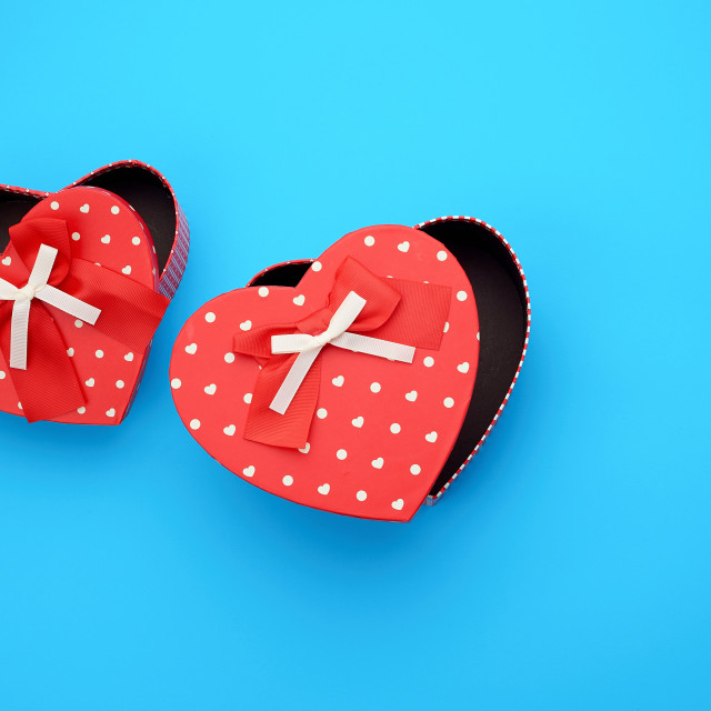 """""""open empty red cardboard box in the form of a heart on a light b"""" stock image"""