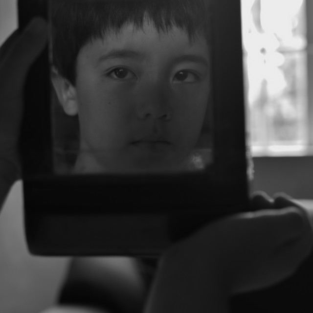 """""""The boy in the mirror."""" stock image"""